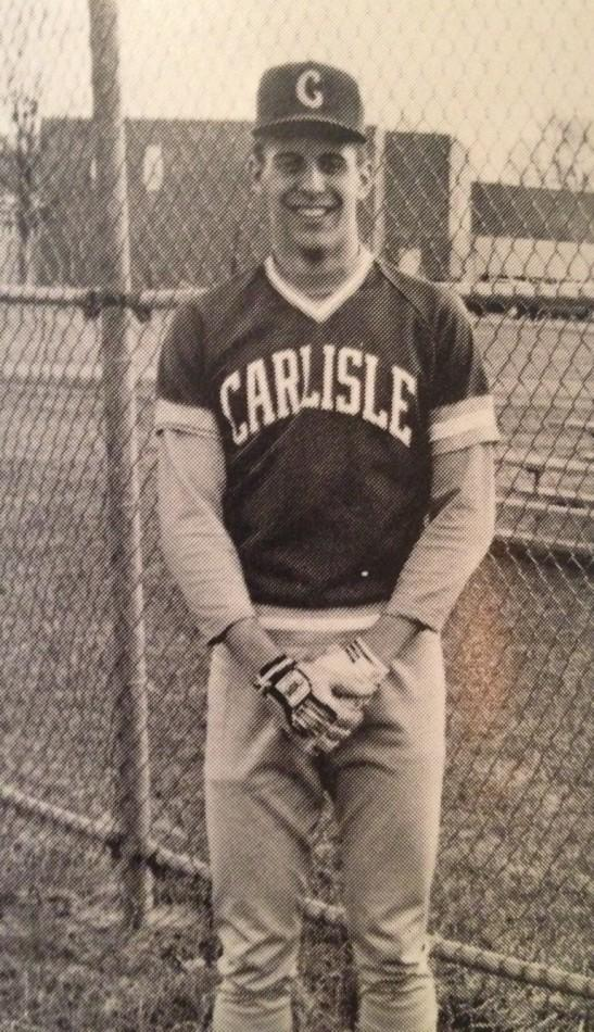 Doug Harris poses for a baseball picture during his senior year at Carlisle High School