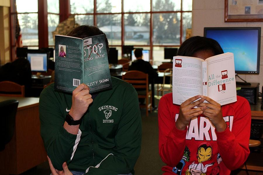 Two students reading Leah Ferguson and Kristy Shinn's books