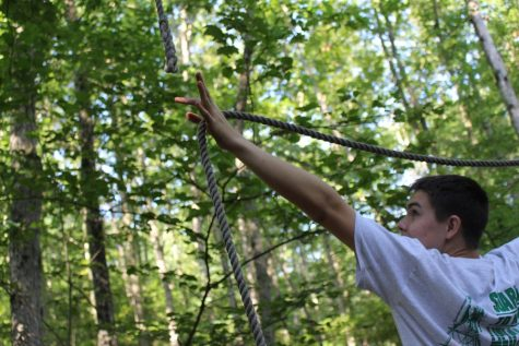 On the low ropes course students