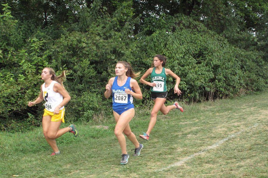 Carlisle sophomore Gracen Cabral runs in the varsity girls' race.