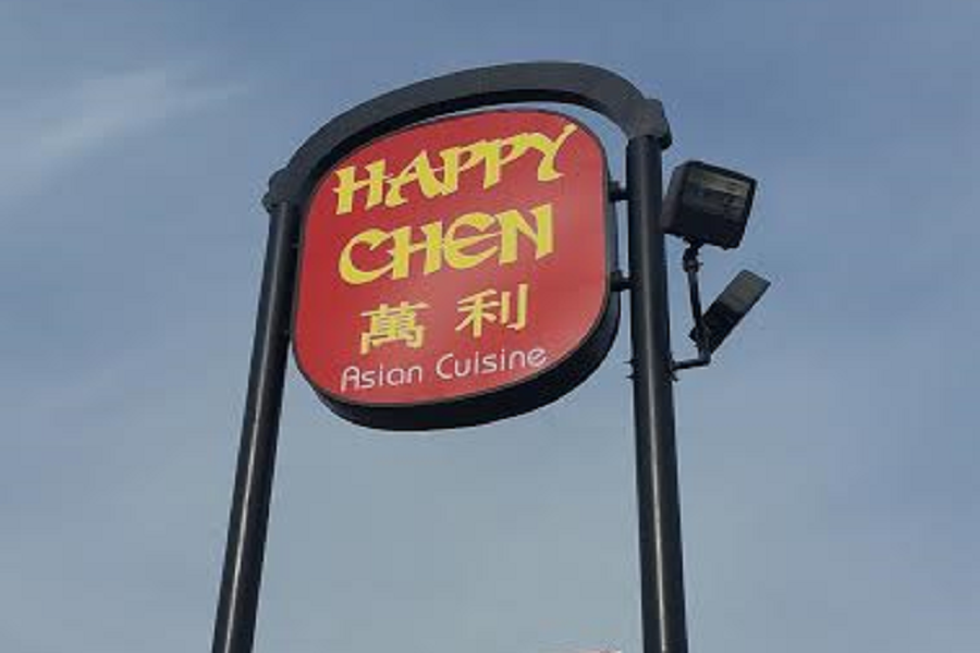 The Happy Chen restaurant welcomes guests with their sign high in the sky.