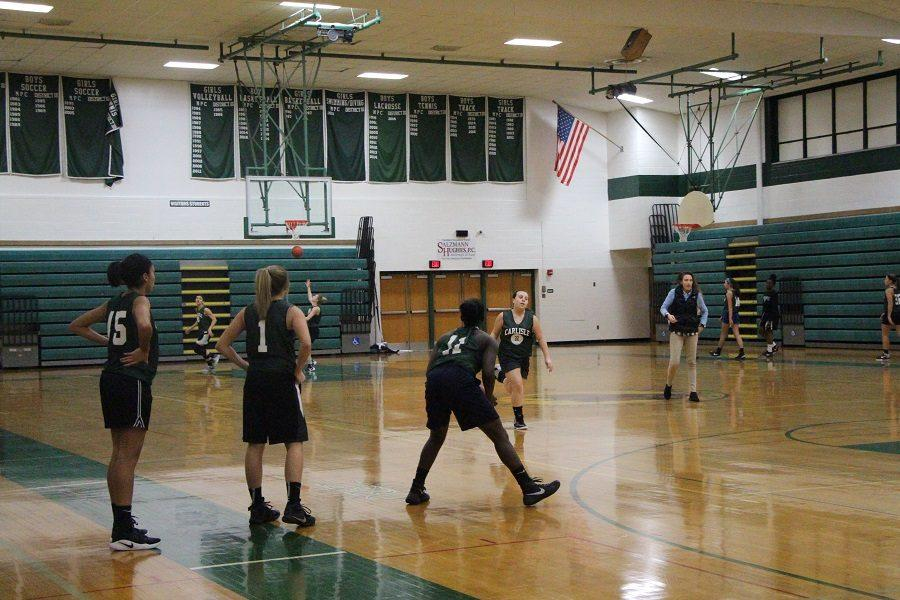 The girls basketball team practices in the McGowan gym.
