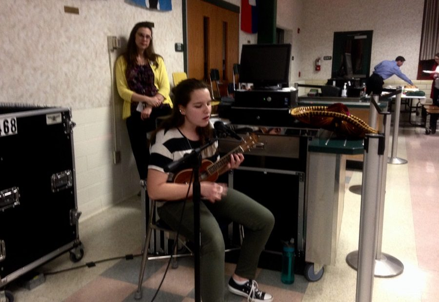 Sarah Ebert, the vice president of the Spanish Honors Society, performs Enrique Iglesias'