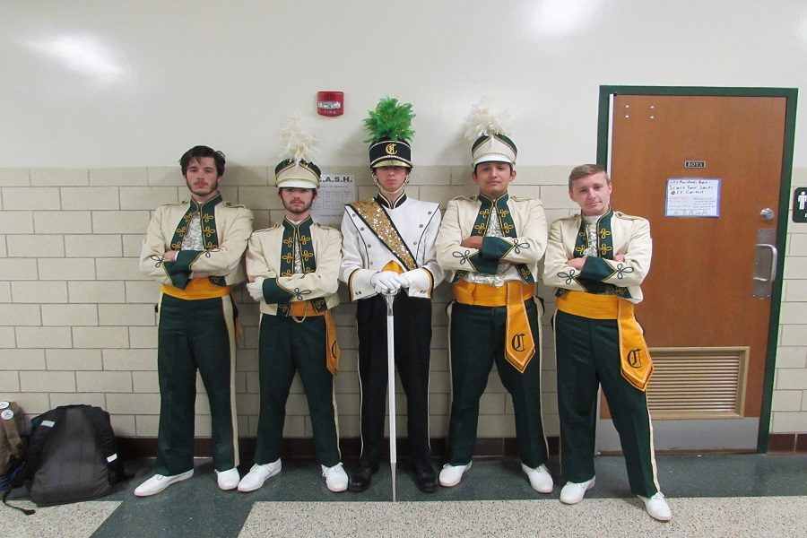 Junior Cameron Fritz, Junior Reese Bower, Senior Ben Adelberg, Senior Miguel Alvarez, and Junior Paul McIlhenny wear matching vintage band uniforms. Blast for the past was a very popular theme day with much participation.