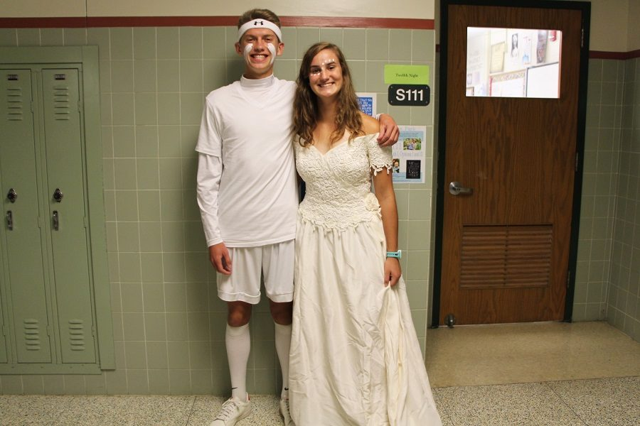 Seniors Emilie Zukowski and Ely Brode show off their class color, white. Zukowski was keeping the tradition of a senior girl wearing a wedding dress alive.