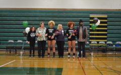 Volleyball double take: Regis twins finish their senior season