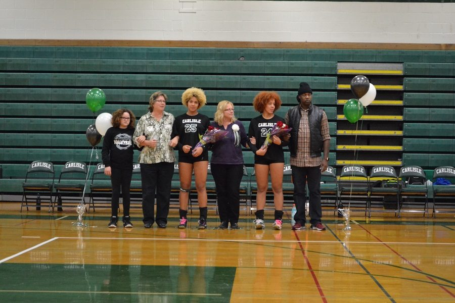 Yanna+and+Shay+Regis+at+senior+night+for+girls+volleyball.+Their+positive+influence+will+be+missed.