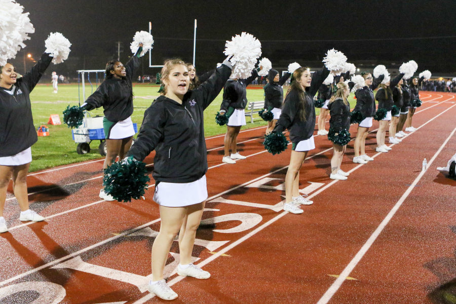 Katie Anderson cheers at home football game. The cheer program will be switching to their winter squad for basketball games, wrestling matches, and cheer competitions.