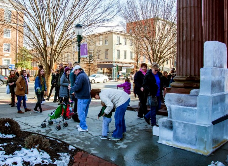 Ice Art Fest attendees try out the CenturyLink ice throne in 2017. CenturyLink is sponsoring the Ice Art Fest again for 2018.