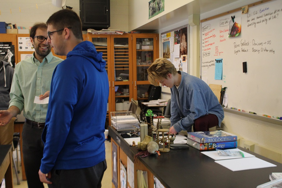 Matthew Prestgaard goes over lesson plans while Biology teacher Jimmy Wilkinson helps students. Prestgaard has been helping Wilkinson teach AP Biology.