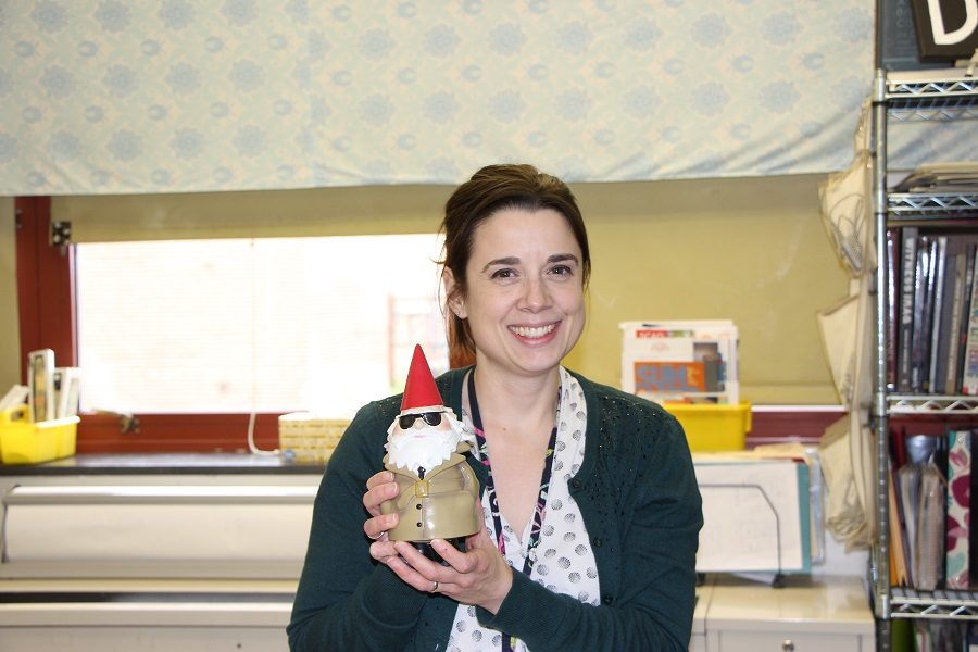 Rachel Drumheller poses with one the many gnomes around her classroom.