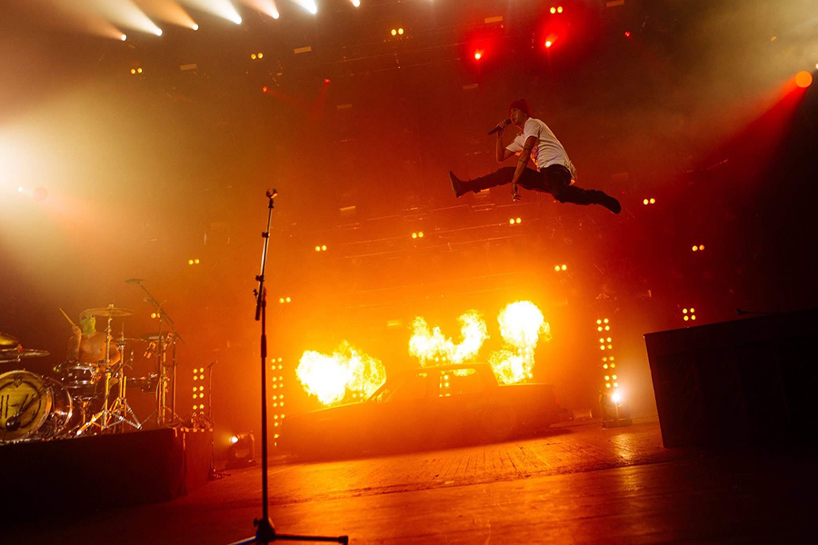 Tyler Joseph jumps on stage during a performance in London. This was the first live performance of recently released songs from the upcoming album