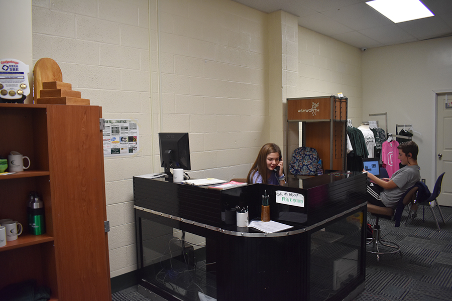 Genia Purdy works in the  CHS's school store, the Bison Corner. The store sells student and teacher-friendly products.