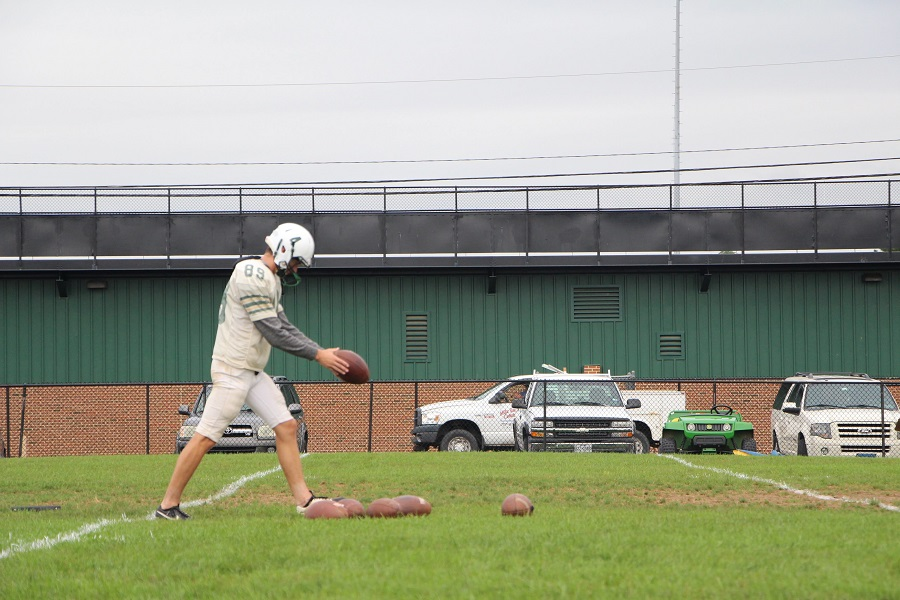 Caleb Richwine prepares to punt the ball at footbal practice.  Richwine raised money throughout the past two seasons for kids with cancer.