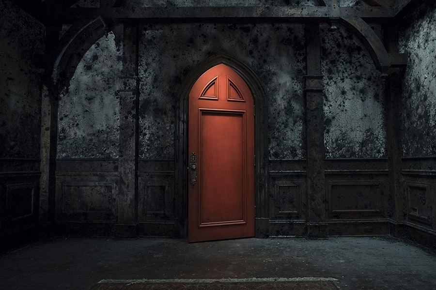 The wooden door, with the dark colored walls adds to the horror factor of the show.  The Haunting of Hill House began streaming on Netflix Oct 6.