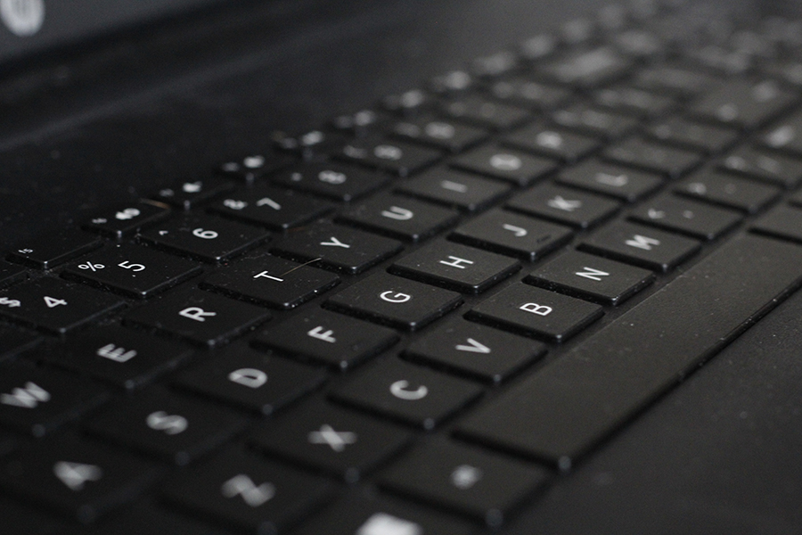 Keyboards of confusion: students struggle with their laptops as the school wifi changes yet again.
