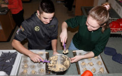 Baking to make things brighter: Students support the community through Project SHARE