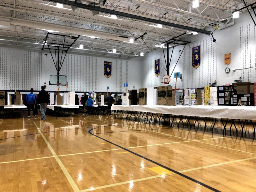 Science+Fair+projects+sit+in+the+gym+at+Yellow+Bridges+Middle+School+prior+to+judging.+The+fair+took+place+over+two+days+at+Yellow+Bridges+Middle+School.
