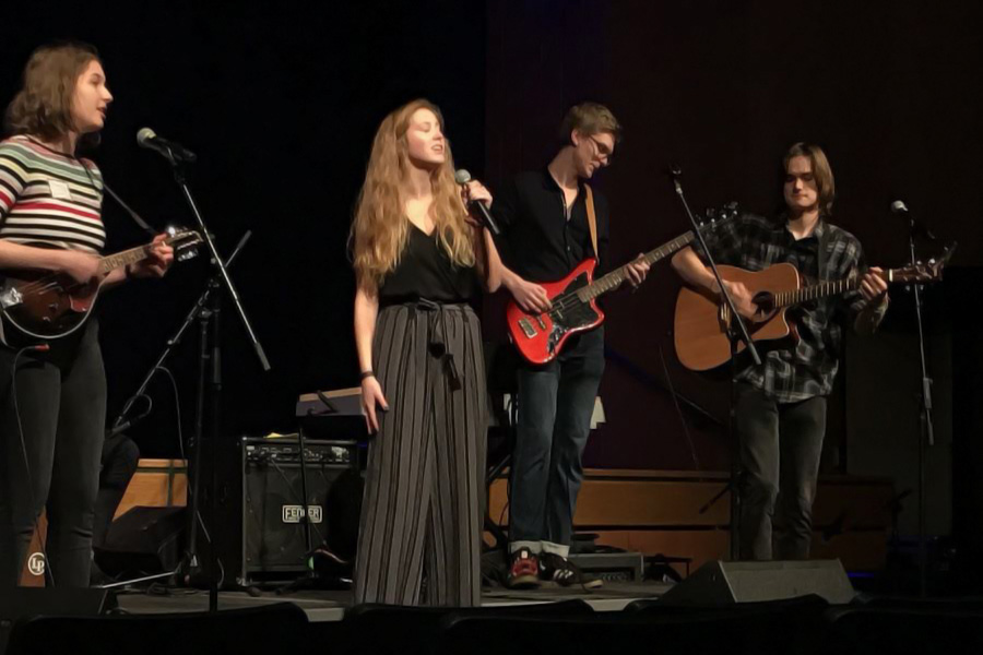 The band Under the Floorboards, including alumni (left to right) Bethany Petrunak, Tali Carlton, Erik Praestgaard, and Sam Blumenthal, performs at the Classic Roast. Although a version of the band still plays at student Coffeehouses, this specific iteration has not performed together for several years.