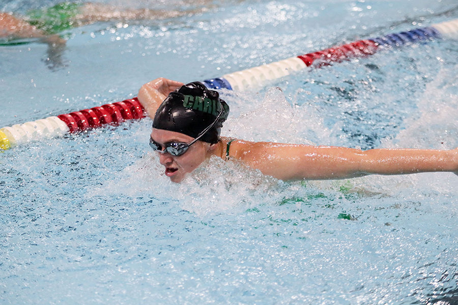 Varsity athlete Sierra Young swims butterfly during a swim meet.  She was a captain this year and will look to return as captain next season.