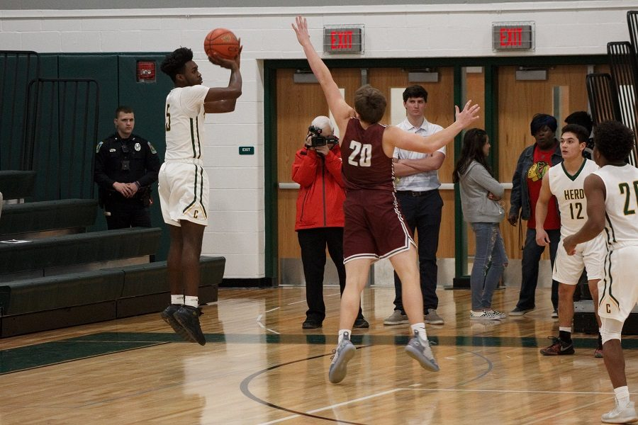 Senior+Dayne+Grays+shoots+a+three-pointer+during+the+first+quarter+of+the+game+vs+State+College.++Grays+scored+7+points+in+the+54-39+upset+win+on+senior+night.