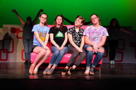 """The Pink Ladies"" played by Talia Clash, Kelsey Sheffe and Bri Murrary, are joined by Chloe Kot (playing Patty Simcox) on stage as the ensemble dances behind them. Participating in the musical allows students to experience the process of staging a musical."