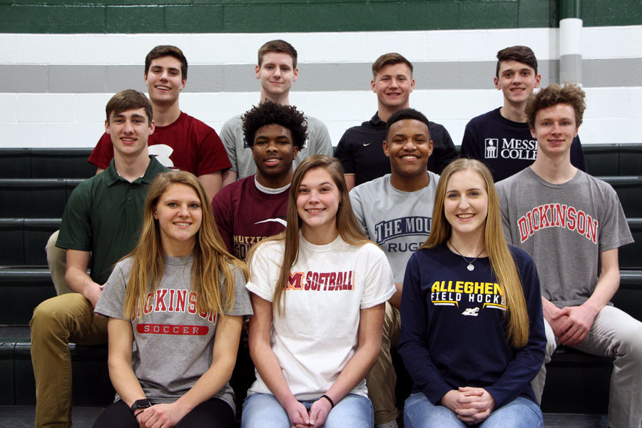These 11 seniors signed to continue playing their respective sports at their future colleges today.  Front row: Meg Tate, Anna Renninger, Becca Winton.  Middle row: Caleb Richwine, Kurtis Ravenel, Matt Carrion, Cole Boback. Back row: Sam Candland, Trevor Hamilton, Grady Chapman, Collin Diehl.