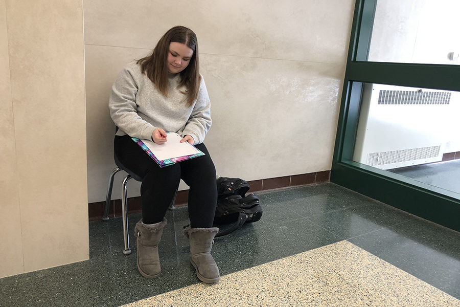 Kate Manti, an 11th grader, continuing her writing in an open atmosphere