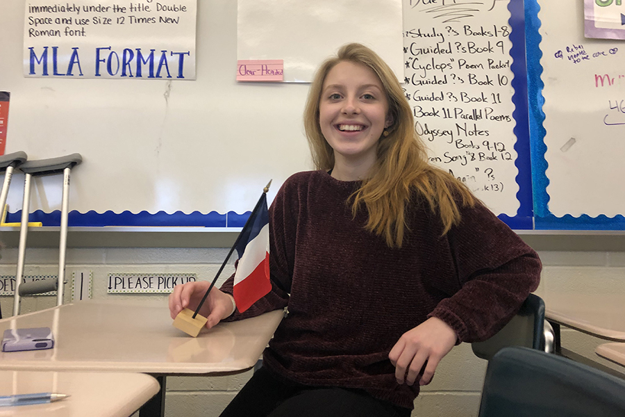 CHS Freshman Hannah Alwine is pictured above with a French flag.  Alwine will be spending a 10 month school year abroad in France through the AFS program and a local fund the Speedwell Scholarship.  She and 19 other local students will go to a foreign-language speaking country for free.