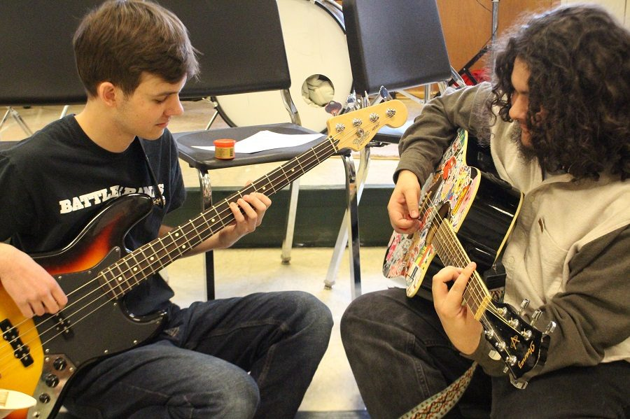 Henry Jansen, left, and Nick Moreno practice together prior to their auditions. Both have been playing for years,a although only Moreno has played in Coffeehouse before.