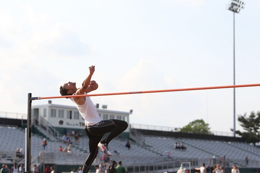 Jumping through the differences: Indoor vs. outdoor track and field