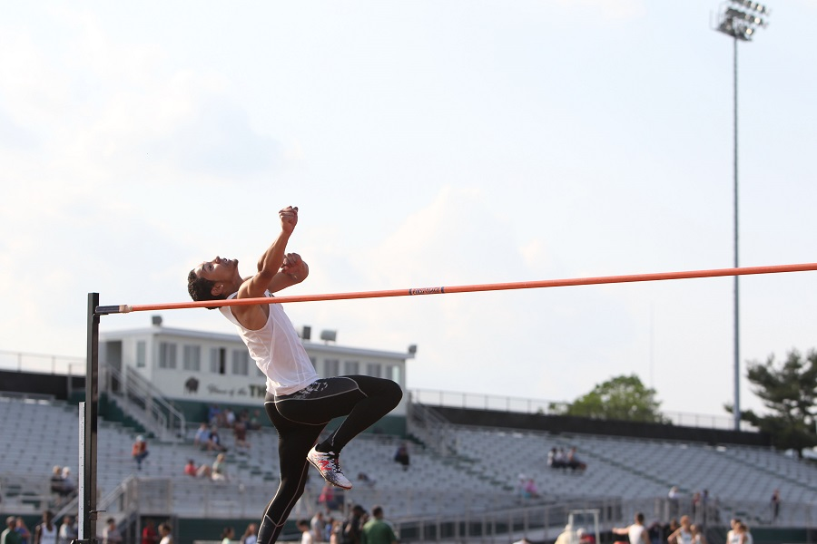 Elijah Ibrahim participates in the high jump during an outdoor meet last season.  He participates in both indoor and outdoor track and field for CHS.