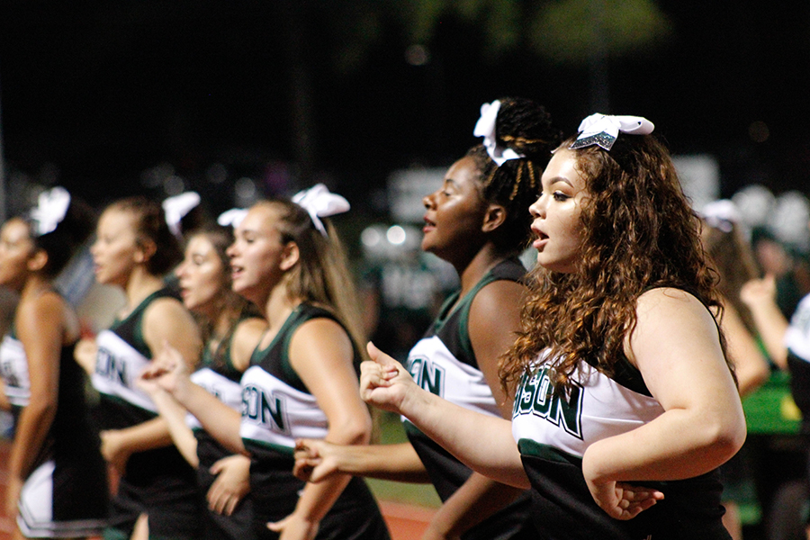 Varsity cheerleaders Mariana Machin (right) and Daija Berry join their fellow team members to perform a routine for Carlisle's football team during the 2018 fall season. The varsity cheerleaders also cheer for the varsity boy's basketball team.