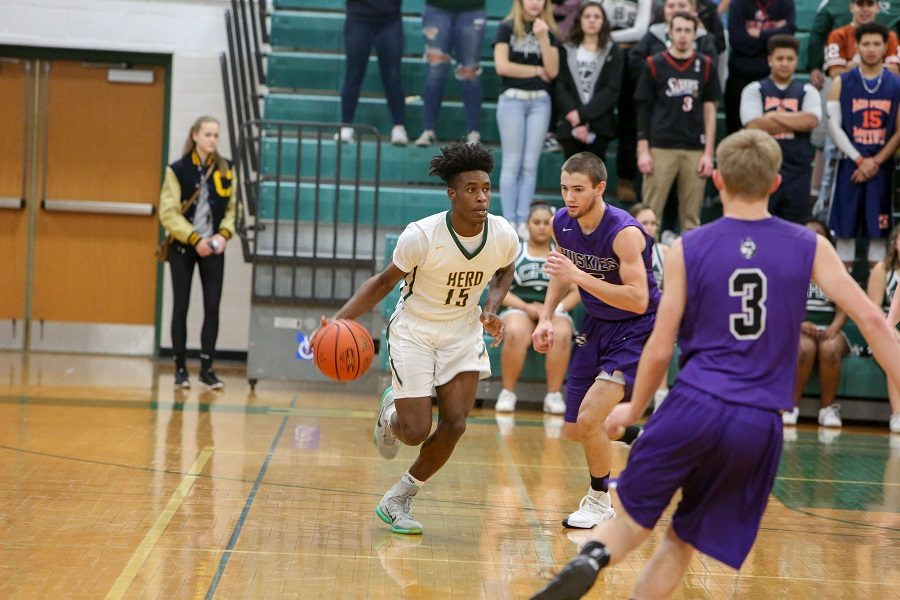 Deshawn+Millington+dribbles+down+the+court+while+playing+in+a+game+his+senior+year.++Millington+is+one+of+CHS%27+athletes+that+went+on+to+play+at+the+collegiate+level.