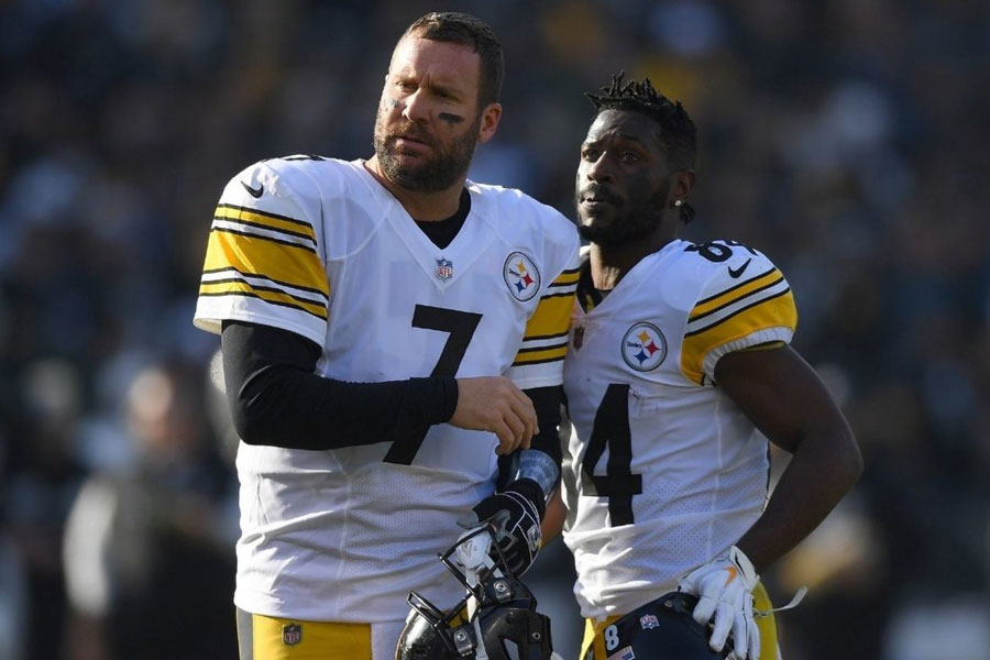 Current Steelers quarterback Ben Roethlisberger and former Steelers wide receiver Antonio Brown watch from the sidelines during a game in the 2018 regular season. A public clash between the two stars resulted in Brown's trade to the Oakland Raiders.