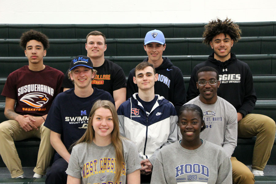 9 seniors celebrated signing with the respective colleges on April 17. Front row: Jessica Petrunak, Marlise Newson. Middle row: Caleb Padgett, Seth Collins-Bloomquist, Nicolas Nunnally. Back row: Howie Rankine, Dylan White,  William Mosinski, Jaden Motter