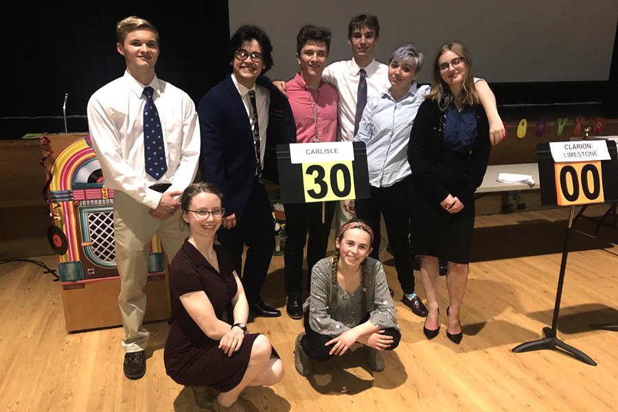 From left: Eli Plant, Lillian Sweeney, Brady Chilson, Ellie Knapp, Salko Hrnjic , Hayden Edwards, Condor Hall, and Ava Wendelken pose as a team after the state Academic Decathlon competition. All eight students competed on March 15 and March 16.