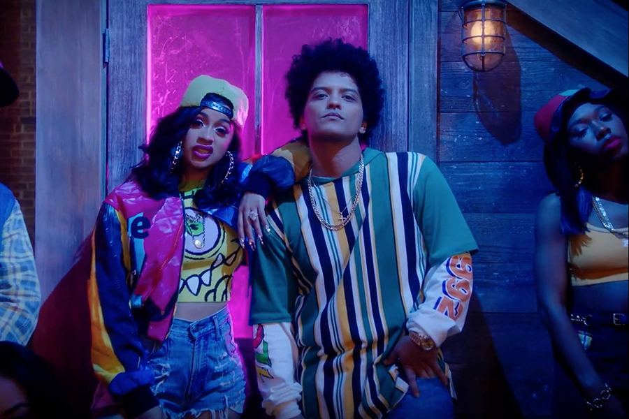 Cardi B and Bruno Mars pose in the video for their release