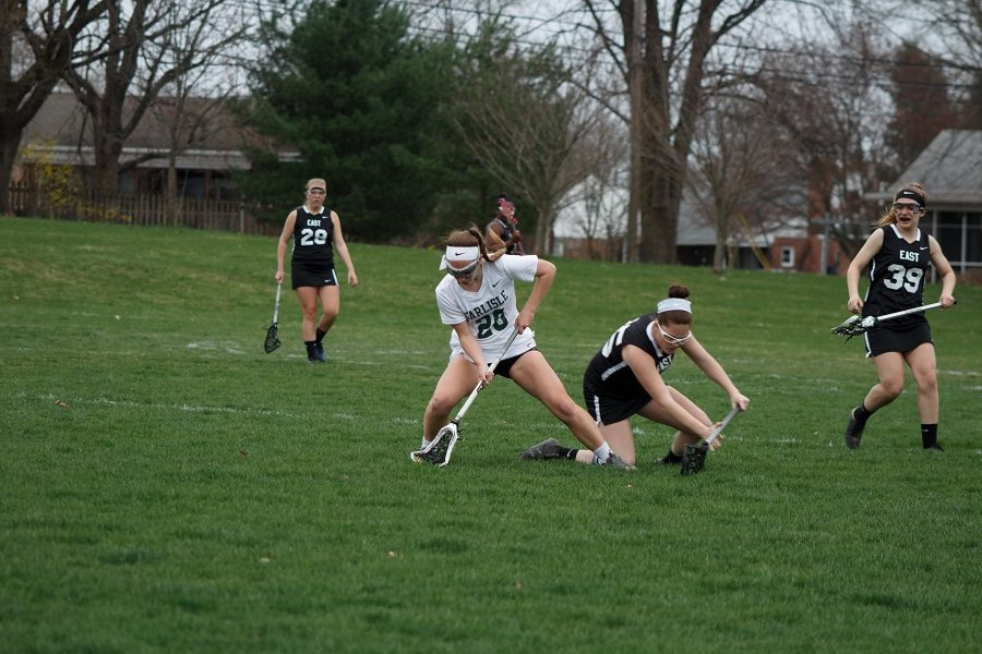Kayla+Reifsteck+retrieves+the+ball+in+the+girls+lacrosse+game+against+Central+Dauphin+East+on+Apr+8.++