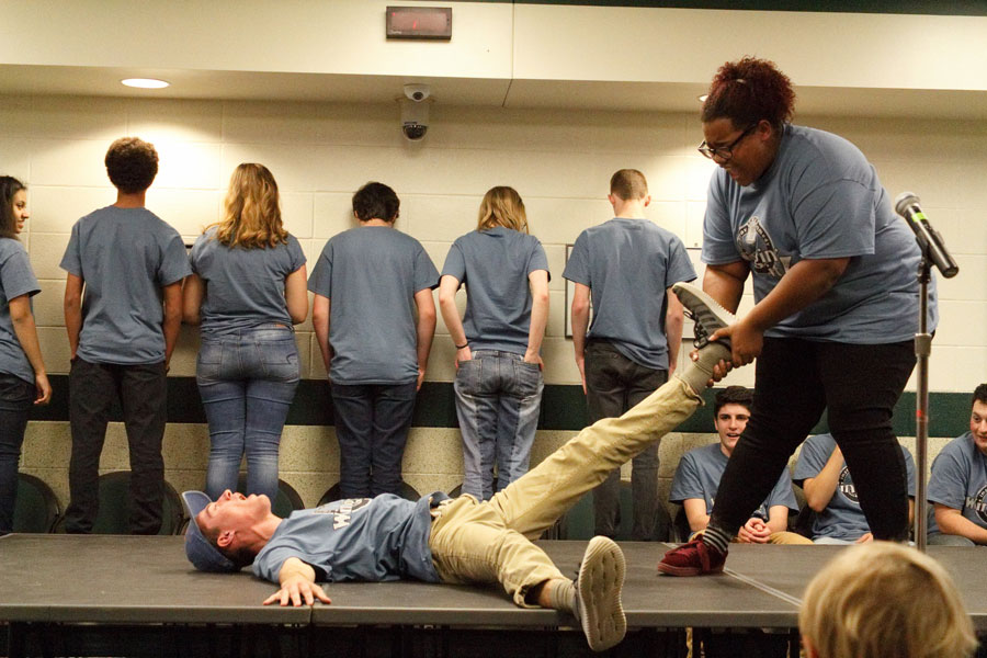 During a game of Blind Freeze Tag, junior member Matthew Keating is pulled across the floor by fellow junior Brooke Carpenter, during a fall performance.  The troupe organized the Wingin' Fit to capitalize on their physicality while also helping them raise money for their trip to Chicago this summer.