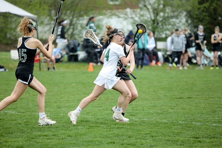 Madison Kelley sprints down the field looking for a goal. This is Kelley's second year on the varsity lacrosse team.