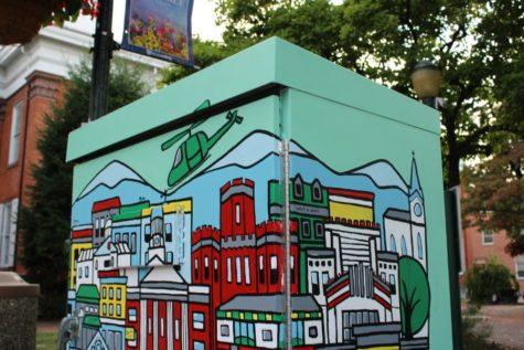 One of the many electrical boxes sponsored by Color Carlisle sits in the town square. The box was designed and painted by art teacher Amie Bantz.
