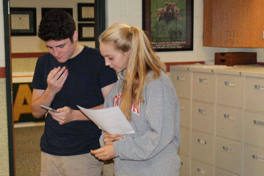 James Echevarria and Olivia Renault read the announcements from a paper provided each morning.  The announcements occur every morning and on Fridays there is a joke of the week.
