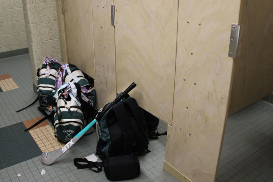 Girls field hockey has to change in the bathrooms due to not having a locker room this season.  Field hockey is one of three girls teams in this situation.