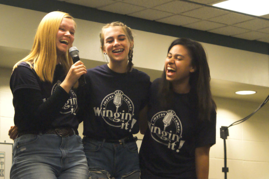 Juniors Reese Daugherty, Josetta Checekett, and Trinity Johnson laugh together while playing a game.  The Wingin' It ! shows will not only get audience members laughing but members of the troupe too.