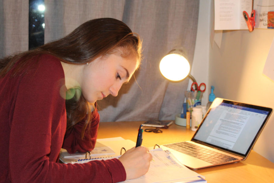 Juniors, like Lulu Herman (seen here) can find themselves up late into the night, working on homework and studying for tests.  Junior year is often seen as the most crucial year due to it being the most recent year seen by colleges during the application process.