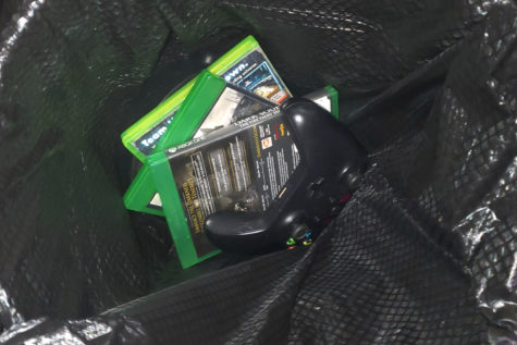Video games and controller shown thrown in trash, as social media protests can sometimes be directed towards violent video games.