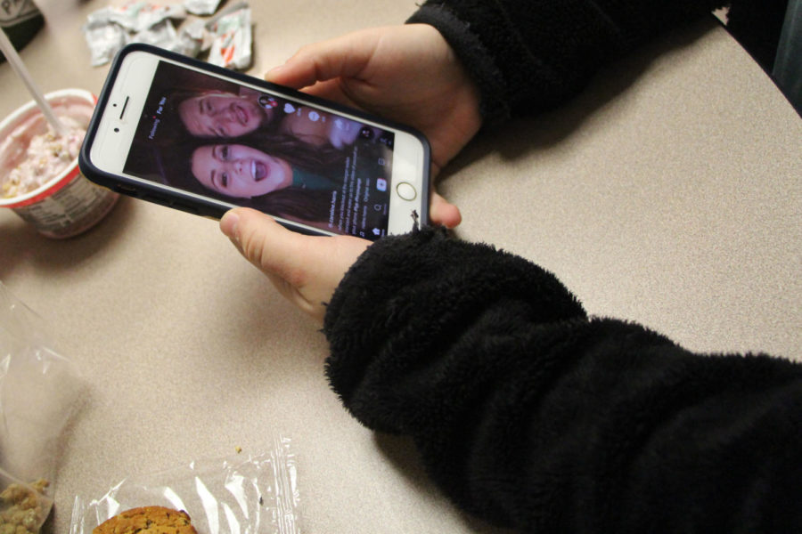 Students spend time during lunch scrolling through and watching Tik Toks. Is the popular social media app in danger of being shut down?