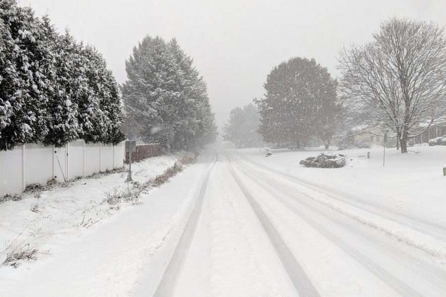 Layers of snow and ice cover a local road. When inclement weather makes travel to and from school impossible, is it better to use a Flexible Instruction Day that day or a snow make-up day later in the year? Our two Editors-in-Chief debate this very question.