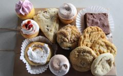 An assortment of cupcakes, brownies, cookies, scones, and cinnamon rolls are laid out from Nothing Sweeter.  This bakery is new to Carlisle and is located on Pomfret St.